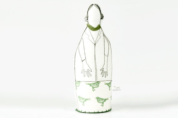 Mother, aunt, friend or grandmother you probably know this woman. Handmade cloth doll in black & white and  Green birds