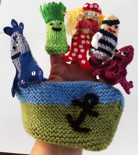 Mermaid and friends finger puppets in a boat