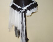 shabby vintage inspired bustle.....black leather with ruffles of ivoryl lace,netting and crochet