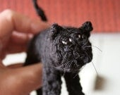 Large knitted black cat