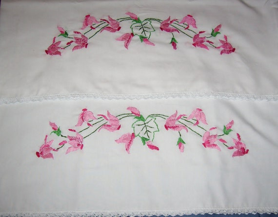 Hand embroidered floral pillow cases with lace edge