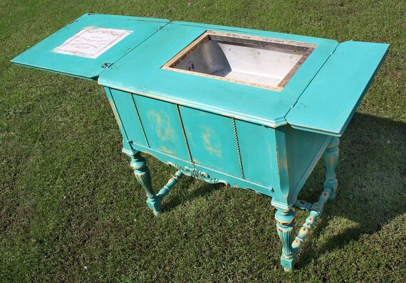 Repurposed Upcycled Distressed Sewing Machine Storage Cabinet Side Table of Recycled Found Objects