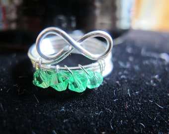 Silver wire wrapped infinity MAY birthstone ring with emerald green crystals, can be made in any size