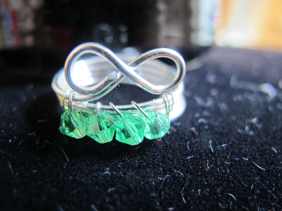 Silver wire wrapped infinity MAY birthstone ring with emerald green Swarovski crystals, can be made in any size