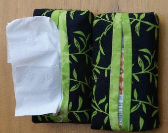 Handmade black and line green fabric tissue holder for travel size packs of tissues.