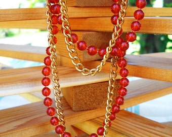 """60"""" double necklace gold tone and rust bead.  flapper necklace."""
