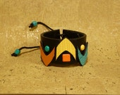CELEBRATE Black Orange Yellow and Turquoise Re Cycled Belt Leather with Metal Brad Details Cuff