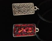 Flaming orange/red dichroic glass pendant with red beads in pewter Celtic design pendant