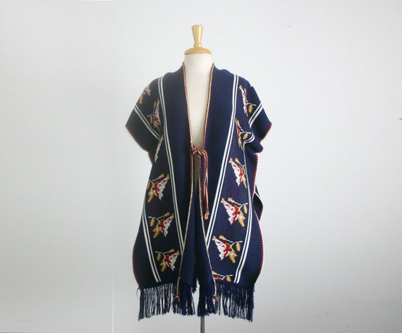 1970s  Vintage knit cape/ poncho in navy blue with a bird motif