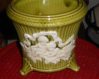 Vintage ceramic green planter with a pair of angels in white