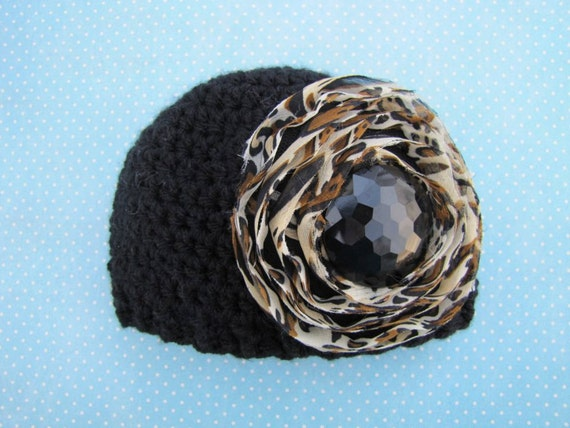 newborn black crochet hat with leopard cheetah print flower and sparkle button