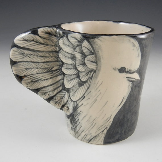 Black and white bird cup with skull and wings