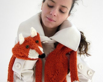 Hand knit fox scarf in red orange with polymer clay buttons, with ears and paws in white.