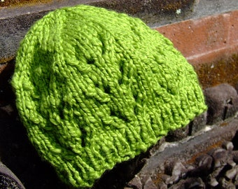 Green knitted baby hat