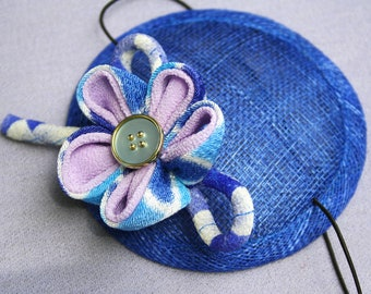 Blue and lilac flower fascinator.