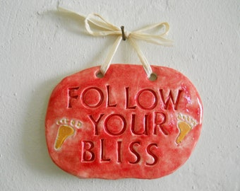 FOLLOW YOUR BLISS hanging ceramic plaque