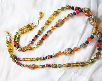 An Incredible Double Strand Necklace Made up of Glass Crystals in AB Orange, Gold, and Green Intermingled With Gold Beads, Black Disks . . .