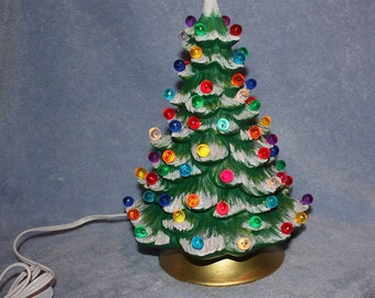 Handpainted ceramic Lighted Christmas Tree covered in little round multi colored bulbs with snow tipped branches