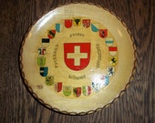 Vintage Switzerland Souvenir Plate with Crest Flags on it