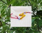 Golf Stroke Keeper, Ten Yellow Golf Counter Beads on Magenta Hemp Cord and Magenta Mini Carabiner Belt-Loop Clip