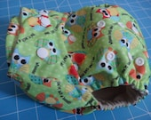 SassyCloth one size pocket diaper with owls on green PUL print. Made to order.