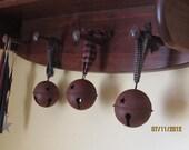 Primitive rusty bells with homespun ribbon