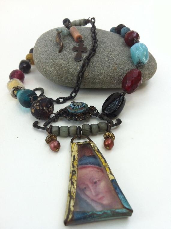 Blue Madonna. A Religious Tin Bezel Reliquary Necklace