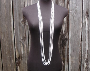 """Vintage long 5 strand 47"""" necklace, white plastic beads, Flapper"""
