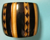 Carved look black,brown,and white Bangle