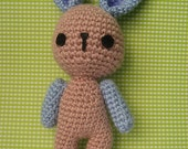 Cute crocheted amigurumi pink and blue bunny