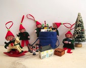 Christmas decorations.  Elves in White, Red & Green