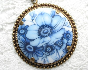 Blue and White Floral Pendant in Antiqued Brass 38mm Round
