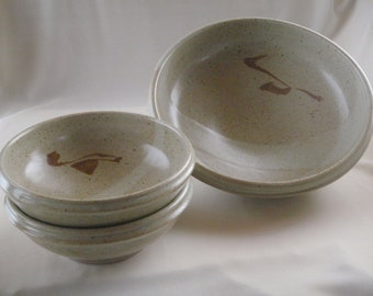 Serving bowl with set of matching smaller bowls.