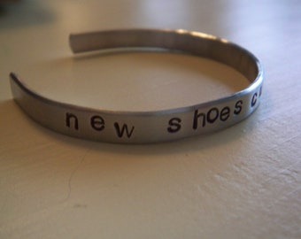 new shoes cure the blues ...a hand stamped cuff bracelet