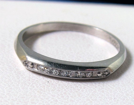 HOLDING--Very Fine Vintage Platinum Diamond Band  with knife edge design