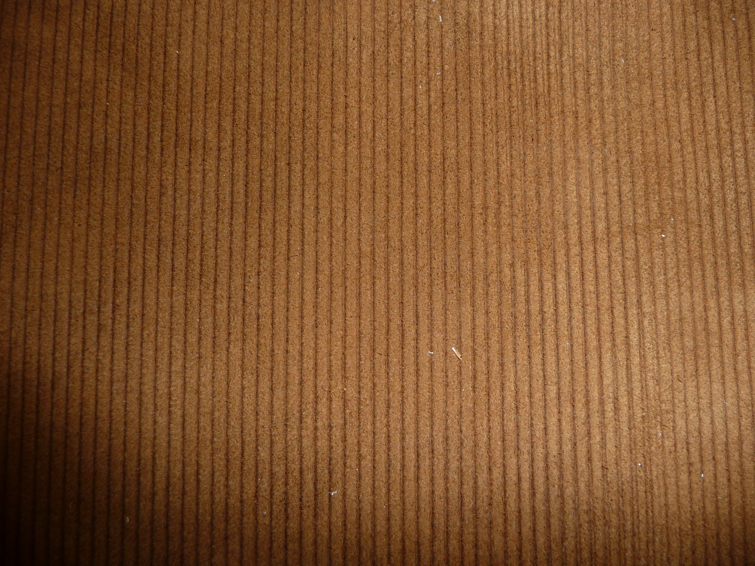 "Corduroy is the quintessential cool-weather fabric and comes in a variety of weights and colors. The width of the cord is commonly referred to as the size of the ""wale,"" or number of cords per inch. The lower the wale number, the thicker the width of the wale (i.e. 4-wale is much thicker than wale)."