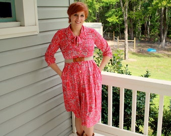 1960s Shelton Stroller pink abstract print day dress. Size M 6-8