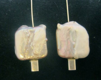Dangling freshwater square pearl earrings on sterling silver mounts.