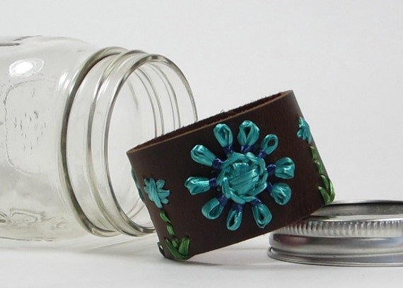 Wanda cuff. Brown leather cuff woven with sky blue, emerald green and navy vintage Swistraw by Ruby Buffalo.