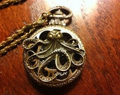 Reserved listing for Karine: Octopus steampunk hollow pocketwatch locket