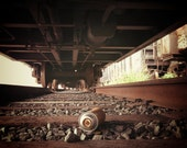 Rusty Spraycan on the tracks under a freight train. Queens NY.