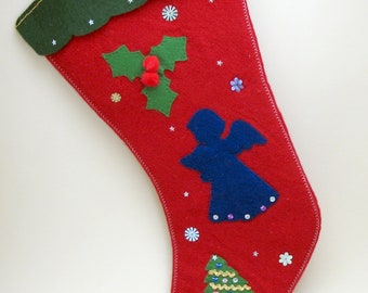 A Blue Angel hymnal in hand sings, Christmas Stocking Red Felt and a  Xmas Tree