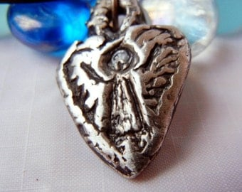 Your Guardian Angel. Boy or Girl Angel. Original Artist, Judy Reno created fine silver angel with wings, protection of your special angel