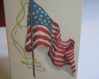 Early 1920's bridge tally card patriotic graphics of an american flag unused