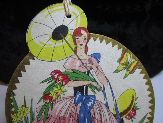 1930's  Art Deco Die Cut  gorgeous bridge tally card with red head in a garden holding flowers and parasol  gold gilded hallmark