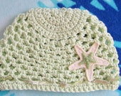 Pale green crochet beanie with starfish fits newborn to 3 mos