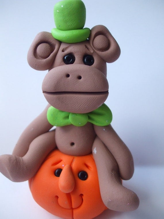 Polymer clay Christmas OrnamentHalloween monkey with a green hat and an orange pumpkinPolymer Clay  2016