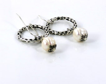 Freshwater pearl hoop earrings. Sterling silver ear wire. Silver hoop light weight .
