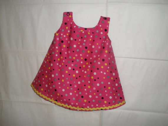 Infant Tunic Dress (0-3 months) beautiful hot pink with polka dots and yellow rick rack trim. Snap clossures on shoulders.