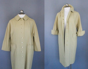 vintage lightweight wool overcoat in a fresh pale green // 1960s vintage coat with cuffed bracelet sleeves // size medium large